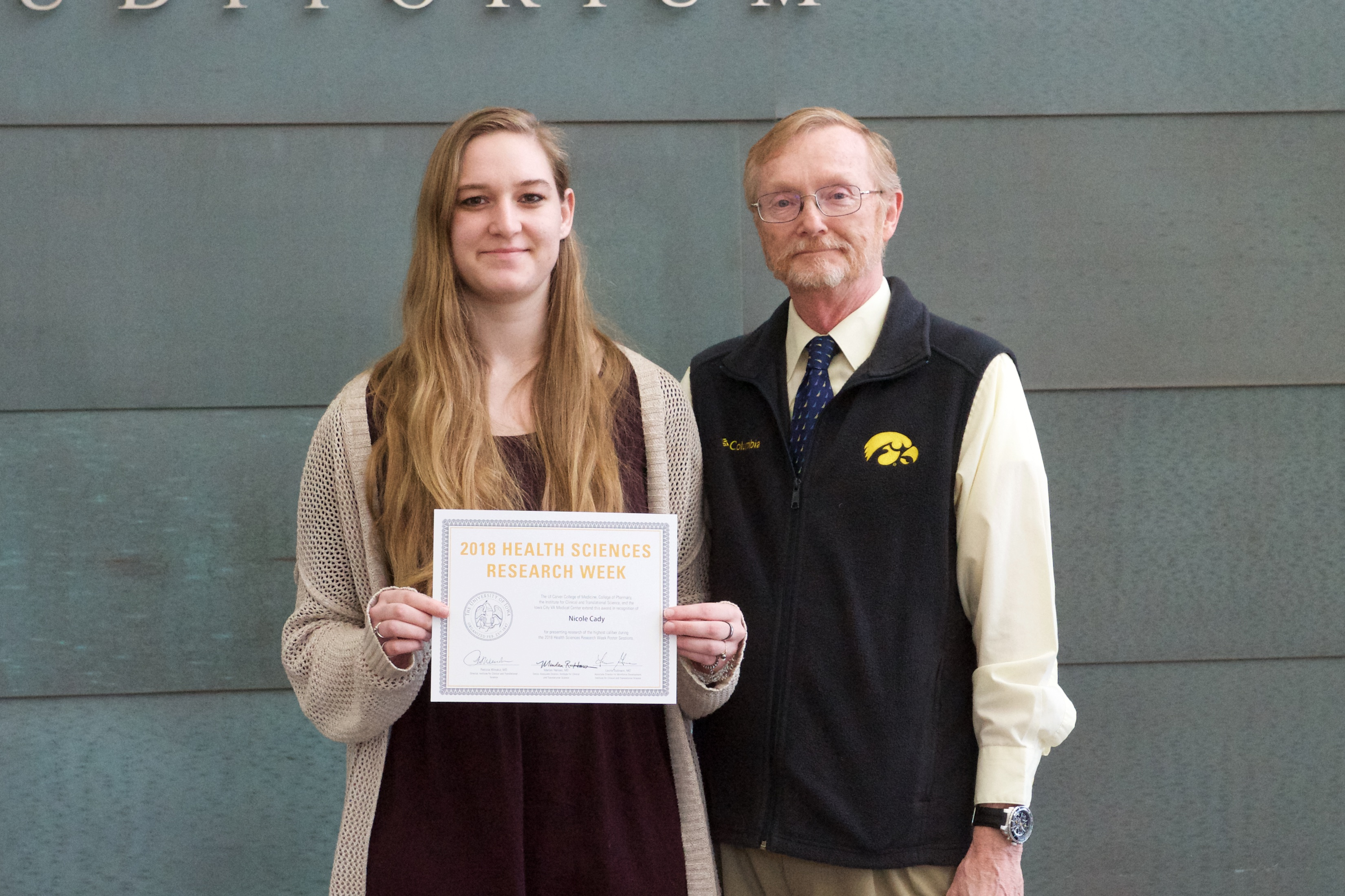 Nicole Cady receiving award